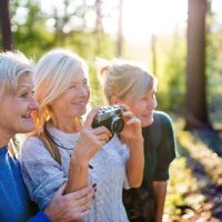 The Gardens of Castle Hills | Seniors photographing outdoors